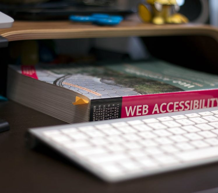 A web accessibility book on top of a work desk